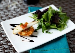 Fried Goat Cheese with Pear, Crispy Prosciutto, and Balsamic Reduction