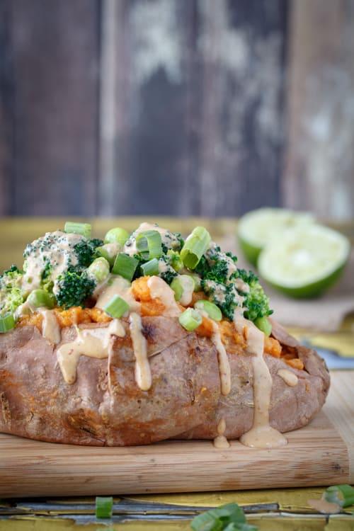 Sweet potatoes stuffed with broccoli, edamame, and thai peanut sauce
