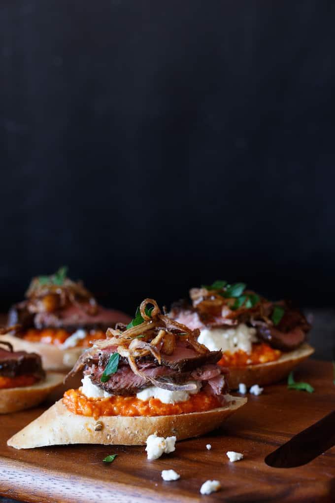 Filet Mignon Crostini with Romesco, Goat Cheese, and Crispy Shallot   sharedappetite.com