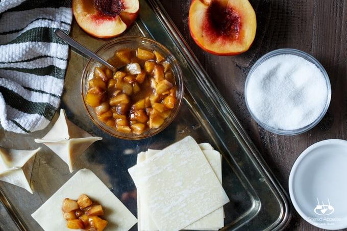Peach Cobbler Wontons with Bourbon Whipped Cream | sharedappetite.com
