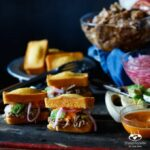 Slow Cooker Pulled Pork Cornbread Sliders with Avocado, Pickled Onions, and Sriracha Mayo | sharedappetite.com