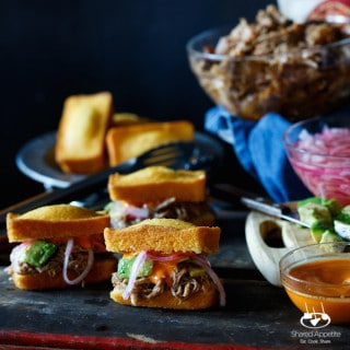 Slow Cooker Pulled Pork Cornbread Sliders with Avocado, Pickled Onions, and Sriracha Mayo   sharedappetite.com