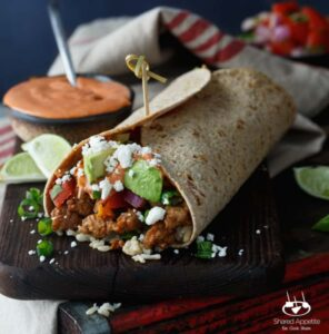 Healthy Korean Pork Burritos with Kimchi, Avocado, and Gochujang Aioli | sharedappetite.com