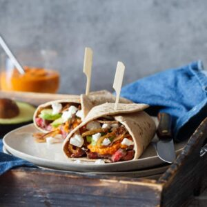 Steak, Romesco, and Goat Cheese Wrap with Avocado and Crispy Shallots