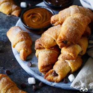 Baked S'mores Churro Bites | sharedappetite.com Ready within 15 minutes, these cinnamon sugar crescent rolls are stuffed with mini marshmallows and chocolate chips!