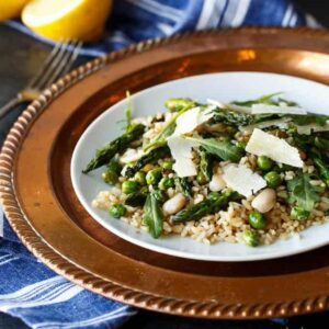 Gluten Free Spring Pea and Asparagus Brown Rice Salad with freshly shaved Parmigiana Reggiano and a bright Lemon Vinaigrette   sharedappetite.com A perfect light and fresh vegetarian meal that's portable and great hot or cold!