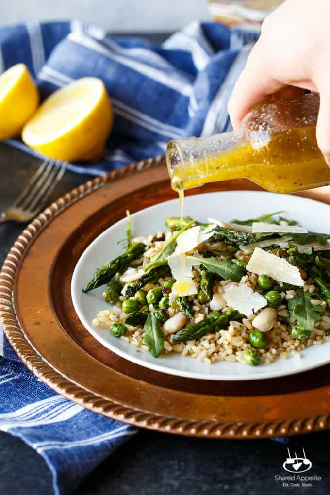Gluten Free Spring Pea and Asparagus Brown Rice Salad with freshly shaved Parmigiana Reggiano and a bright Lemon Vinaigrette | sharedappetite.com A perfect light and fresh vegetarian meal that's portable and great hot or cold!