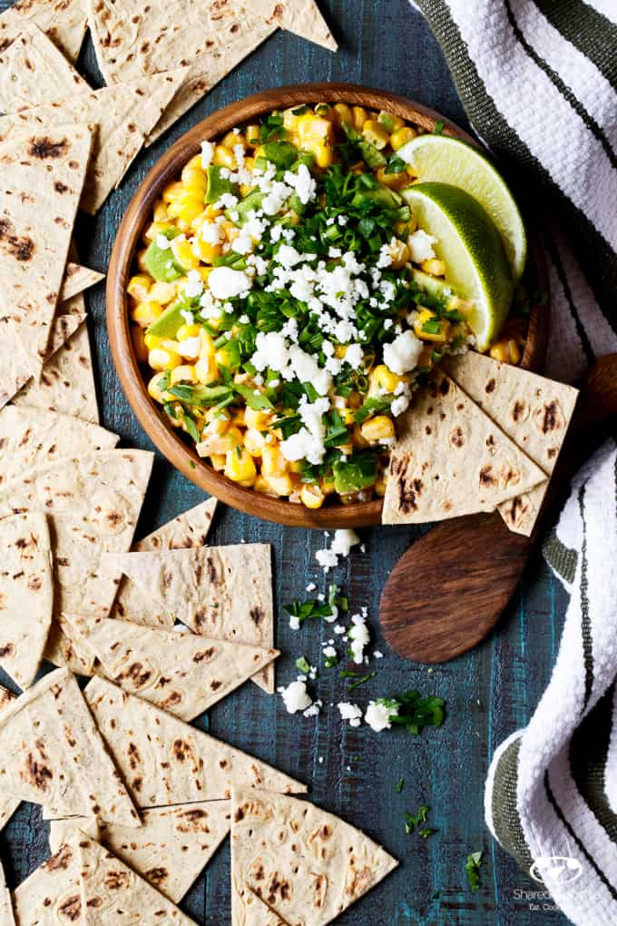 Mexican Street Corn and Avocado Dip   sharedappetite.com All the flavor of traditional Mexican Street Corn, transformed into an easy entertaining summer appetizer dip recipe!