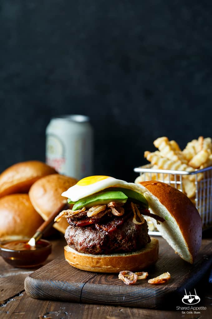 Whiskey Glazed Burgers with Spicy Brown Sugar Bacon, Avocado, Crispy Shallots, and a Fried Egg! A perfect Father's Day EPIC burger   sharedappetite.com