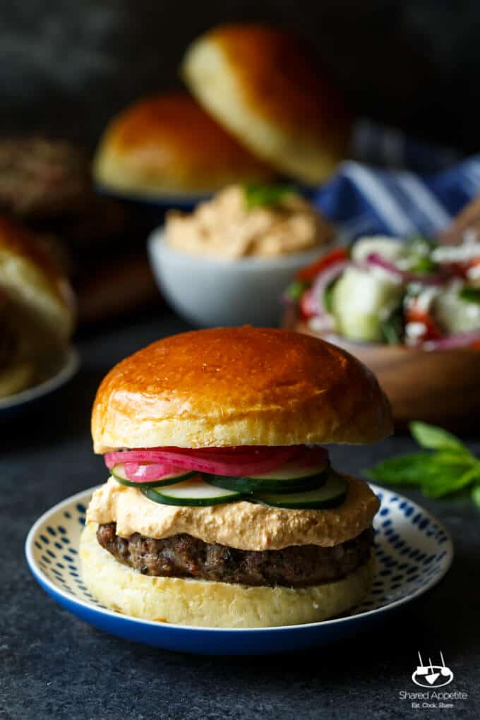Lamb Kefta Burgers with Spicy Whipped Feta, Pickled Onions, and Cucumber | sharedappetite.com