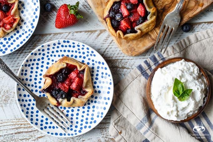 Mini Berry Galettes with Lemon Whipped Cream | sharedappetite.com