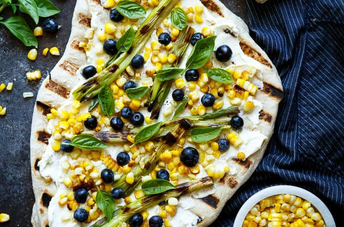 Summer Corn and Blueberry Grilled Pizza with Whipped Goat Cheese and Grilled Scallions. Super quick and easy, perfect for summer easy entertaining! | sharedappetite.com