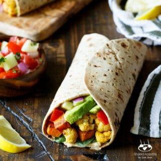 Vegan Curried Cauliflower and Sweet Potato Wrap with Hummus, Avocado, and Israeli Salad | sharedappetite.com