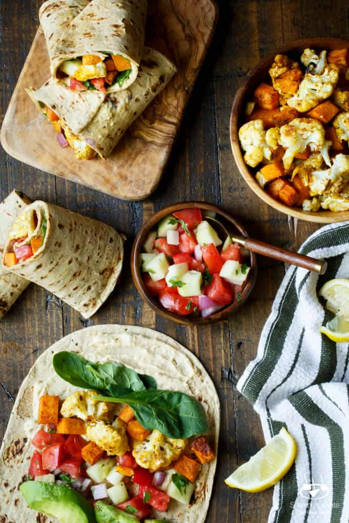 Vegan Curried Cauliflower and Sweet Potato Wrap with Hummus, Avocado, and Israeli Salad | sharedappetite.com