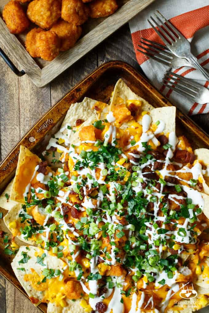 Honey BBQ Chicken Nachos with Bacon, Scallions, Corn, and Ranch Dressing | sharedappetite.com