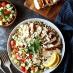 Mediterranean Chicken Quinoa Bowls with Israeli Salad, Hummus, and Tahini Sauce | sharedappetite.com
