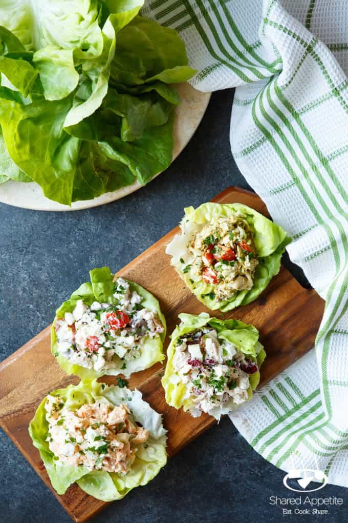 Four Healthy Chicken Salad Lettuce Wraps, including Healthy Greek Chicken Salad, Healthy Caprese Chicken Salad, Healthy Buffalo Chicken Salad, Healthy Apple Cranberry Chicken Salad   sharedappetite.com