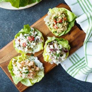Four Healthy Chicken Salad Lettuce Wraps, including Healthy Greek Chicken Salad, Healthy Caprese Chicken Salad, Healthy Buffalo Chicken Salad, Healthy Apple Cranberry Chicken Salad | sharedappetite.com