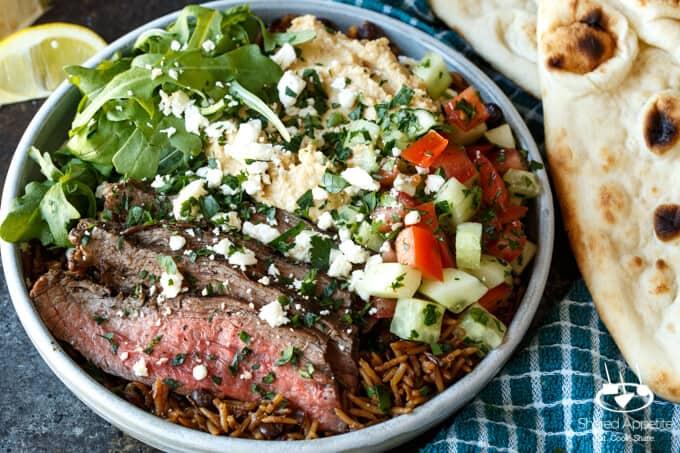 Grilled Flank Steak Shawarma Bowls with Israeli Salad, Hummus, and White Sauce | sharedappetite.com