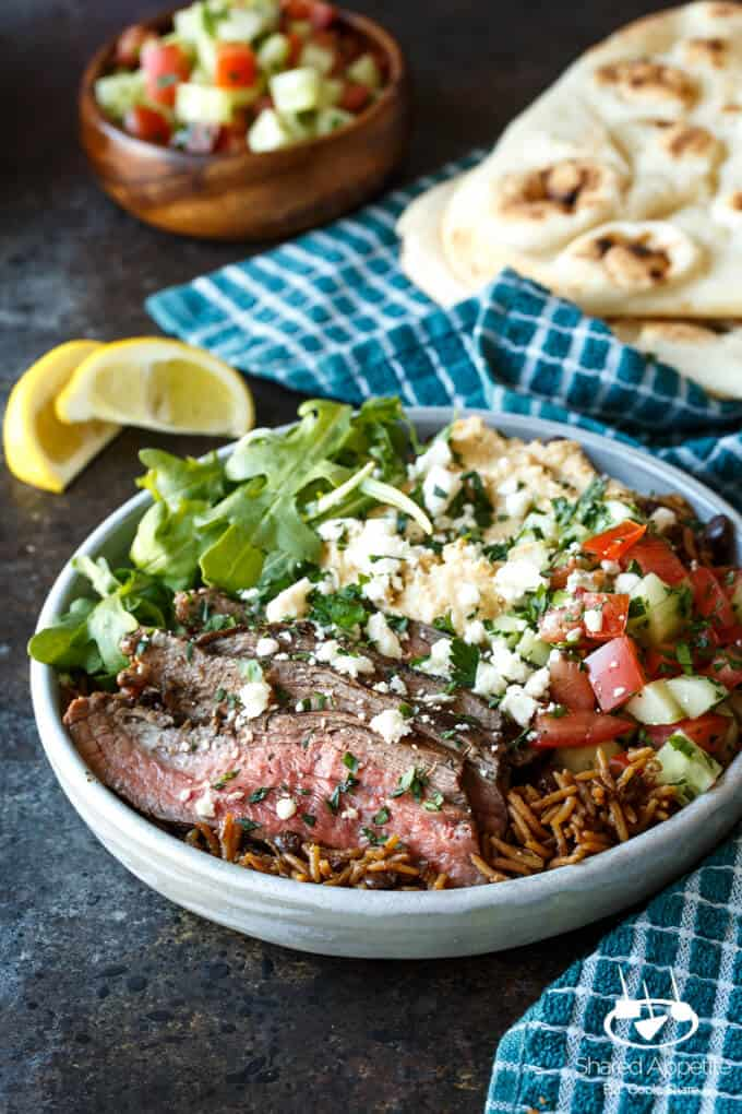 Grilled Flank Steak Shawarma Bowls with Israeli Salad, Hummus, and White Sauce | sharedappetite.com