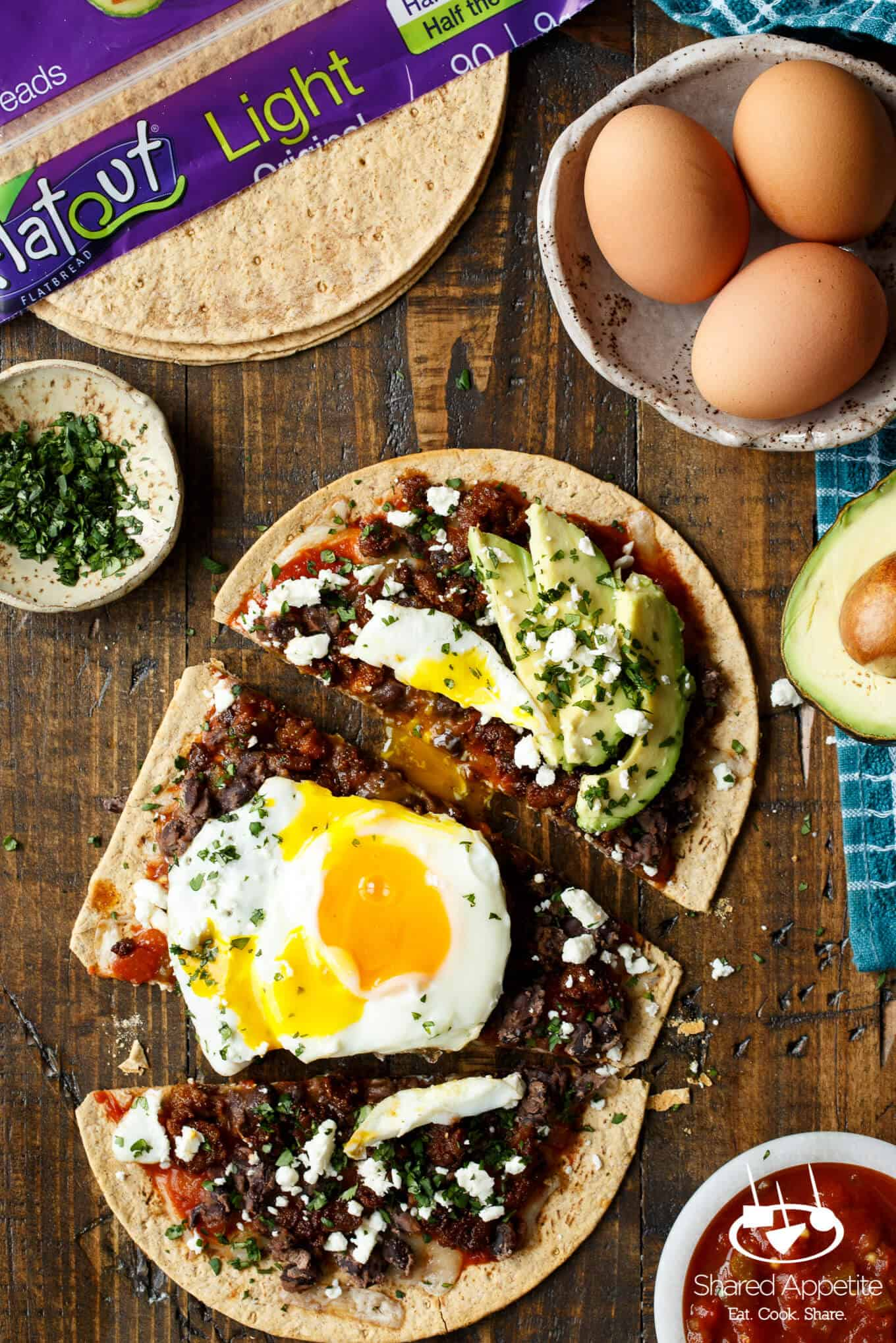 Huevos Rancheros Flatbread Pizza with Monterey Jack Cheese, Salsa, Black Beans, Avocado, and a Fried Egg! sharedappetite.com