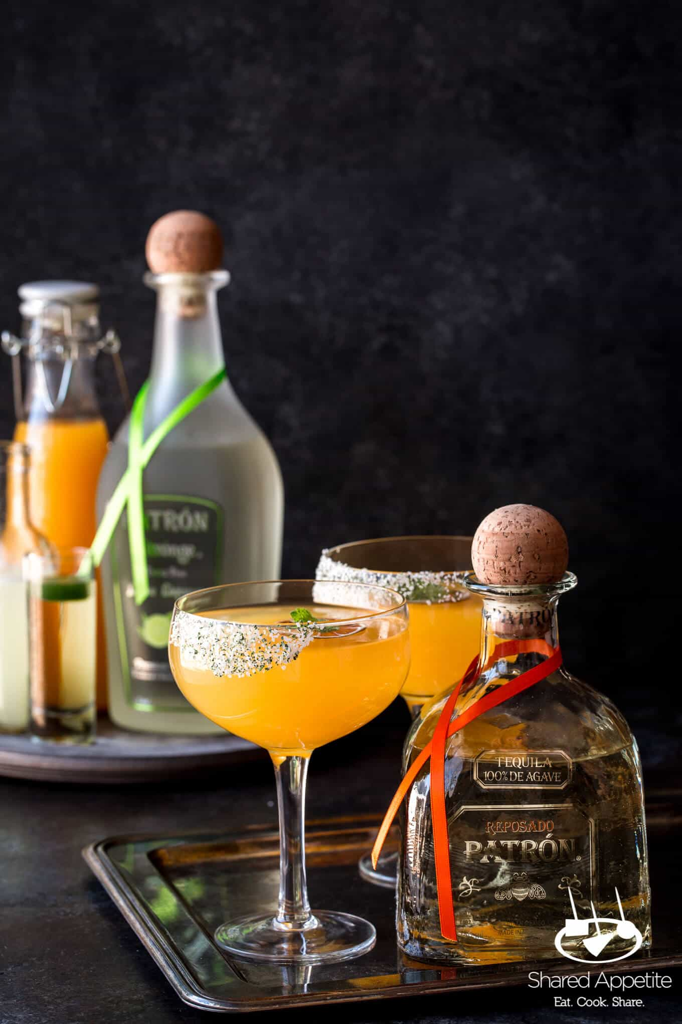 Mumbai Margarita inspired by the flavors of India with Patron tequila, mango puree, spicy rose water syrup, and lots of lime! sharedappetite.com