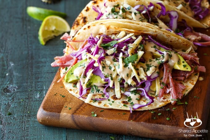 Slow Cooker Corned Beef Tacos Guinness Braised with Guinness Cream Sauce, Red Cabbage, and Avocado | sharedappetite.com