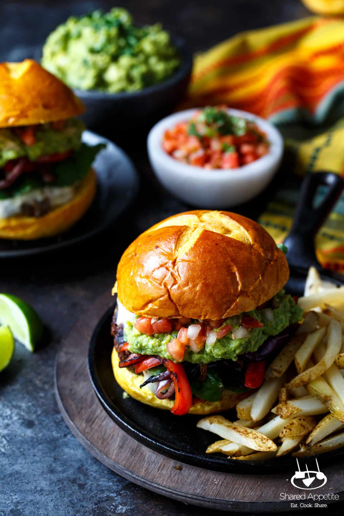 Fajita Burgers with grilled peppers and onions, guacamole, and pico de ...