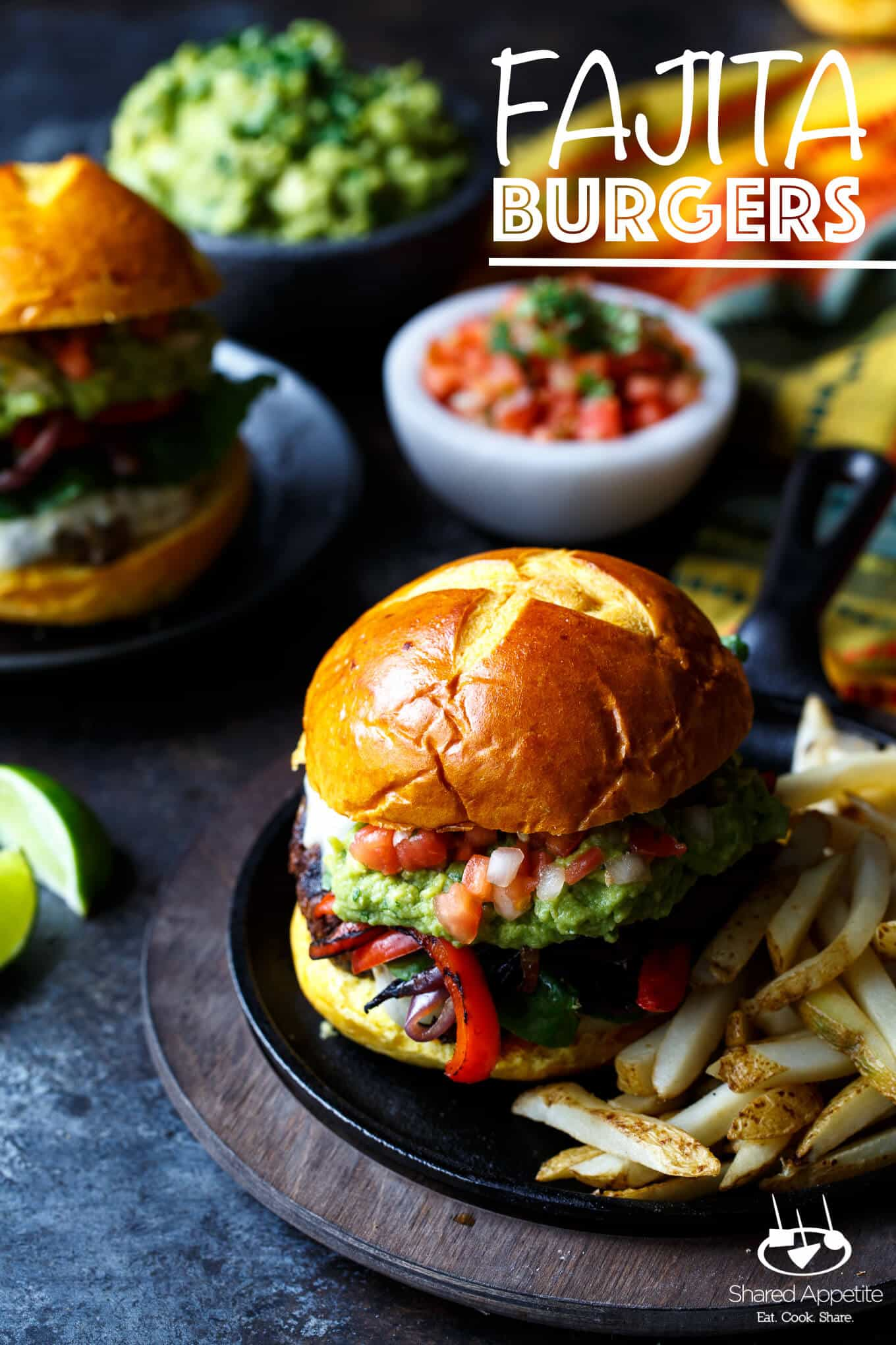 Fajita Burgers with grilled peppers and onions, guacamole, and pico de gallo | sharedappetite.com