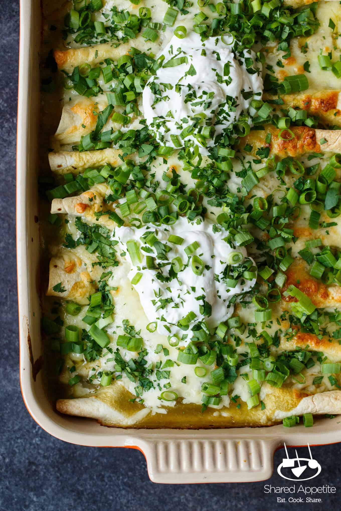 Hidden Veggie Chicken Enchiladas with Zucchini, Spinach, and Corn in a Green Chile Sauce are Family Friendly! | sharedappetite.com