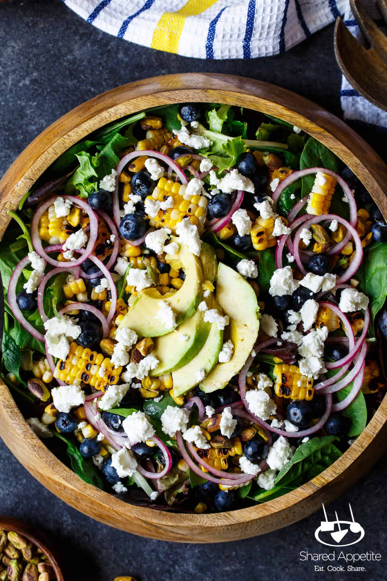Blueberry, Corn, and Goat Cheese Salad with quick pickled onions, avocado, pistachios, and a bright lemon vinaigrette | sharedappetite.com