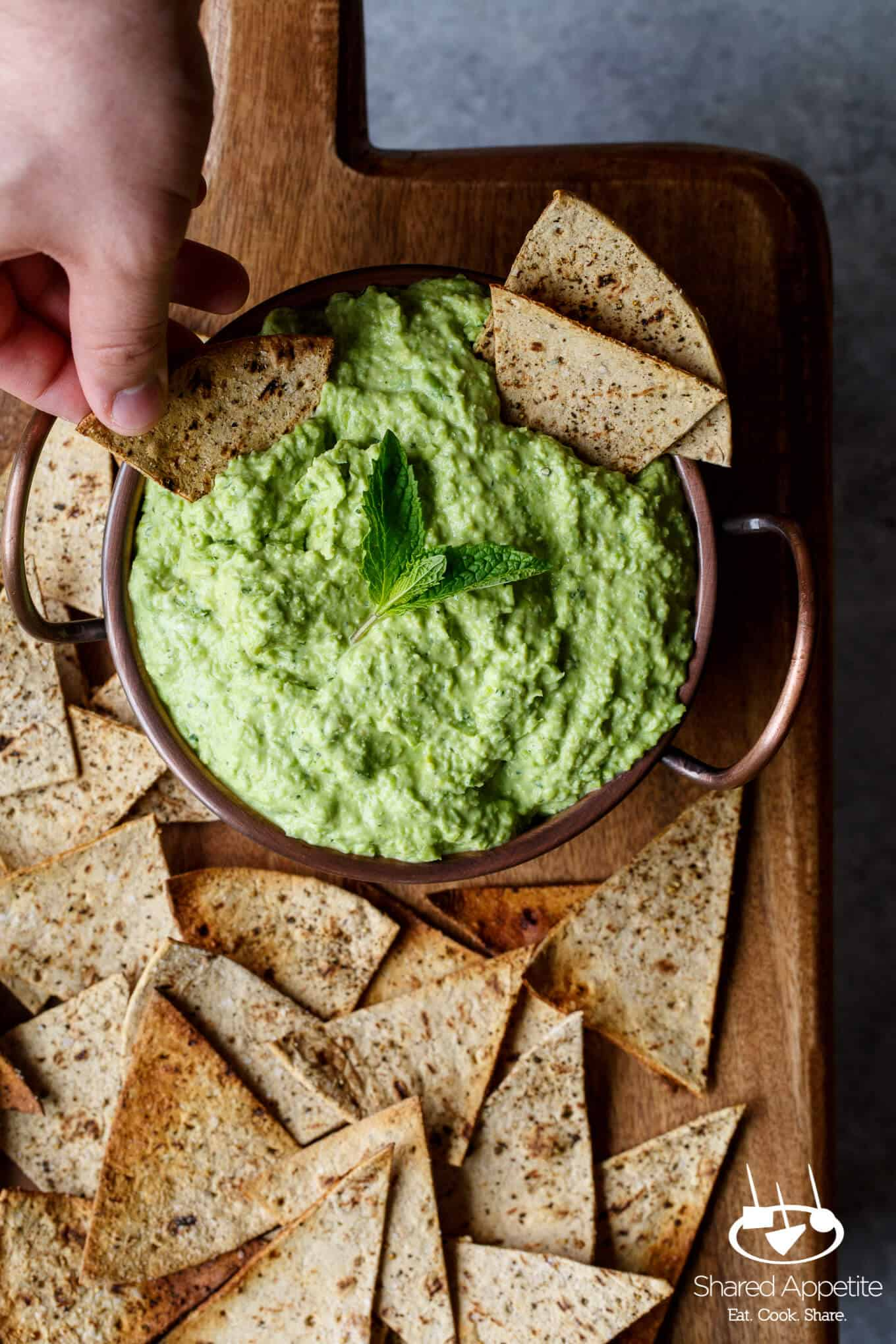 Just a handful of ingredients and 5 minutes stands between you and this easy entertaining recipe for Sweet Pea Goat Cheese Dip with lemon and mint! Perfect for Spring!