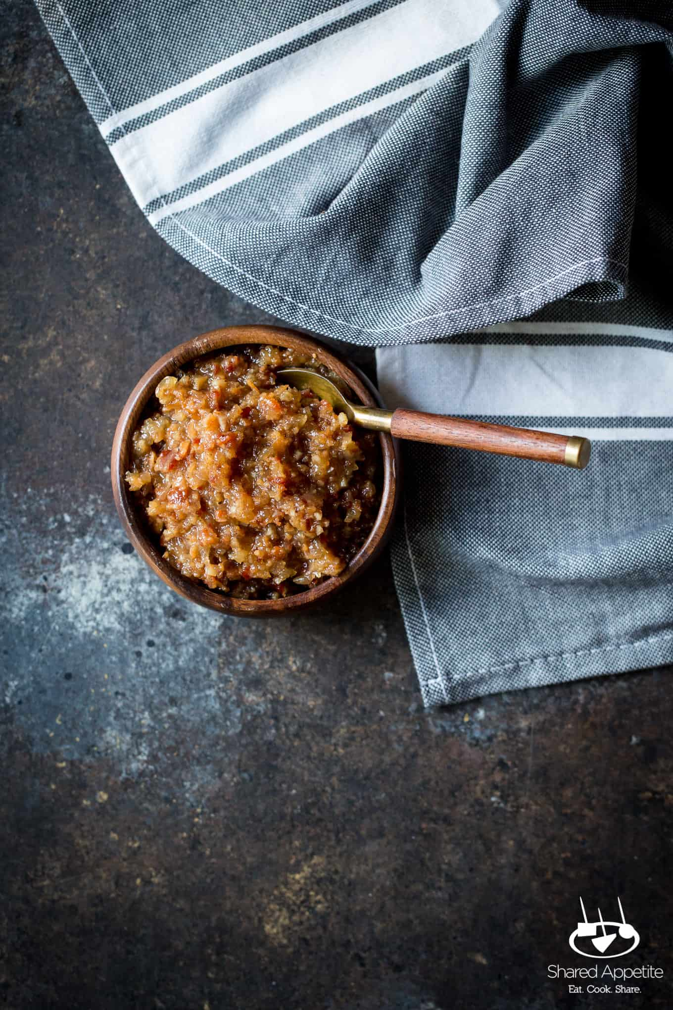 Bacon Jam made with onions, bacon, and apple juice! The perfect condiment for avocado toast, burgers, and goes great with eggs! Full recipe on sharedappetite.com