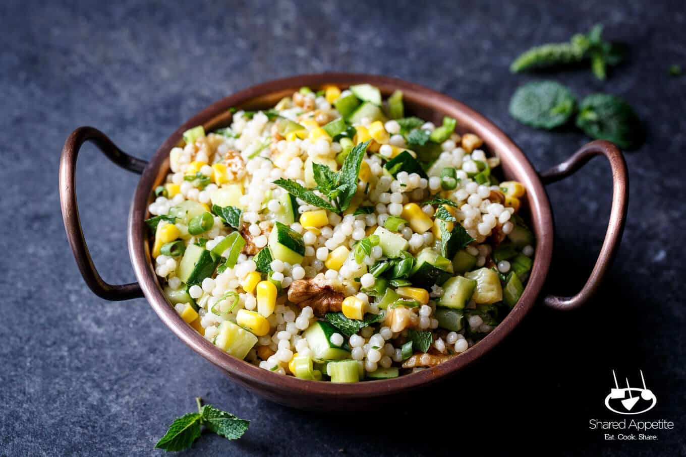 Pearl Couscous Salad with Zucchini, Corn, and Mint to serve as a side to Grilled Lamb Chops with Mint Chimichurri | sharedappetite.com