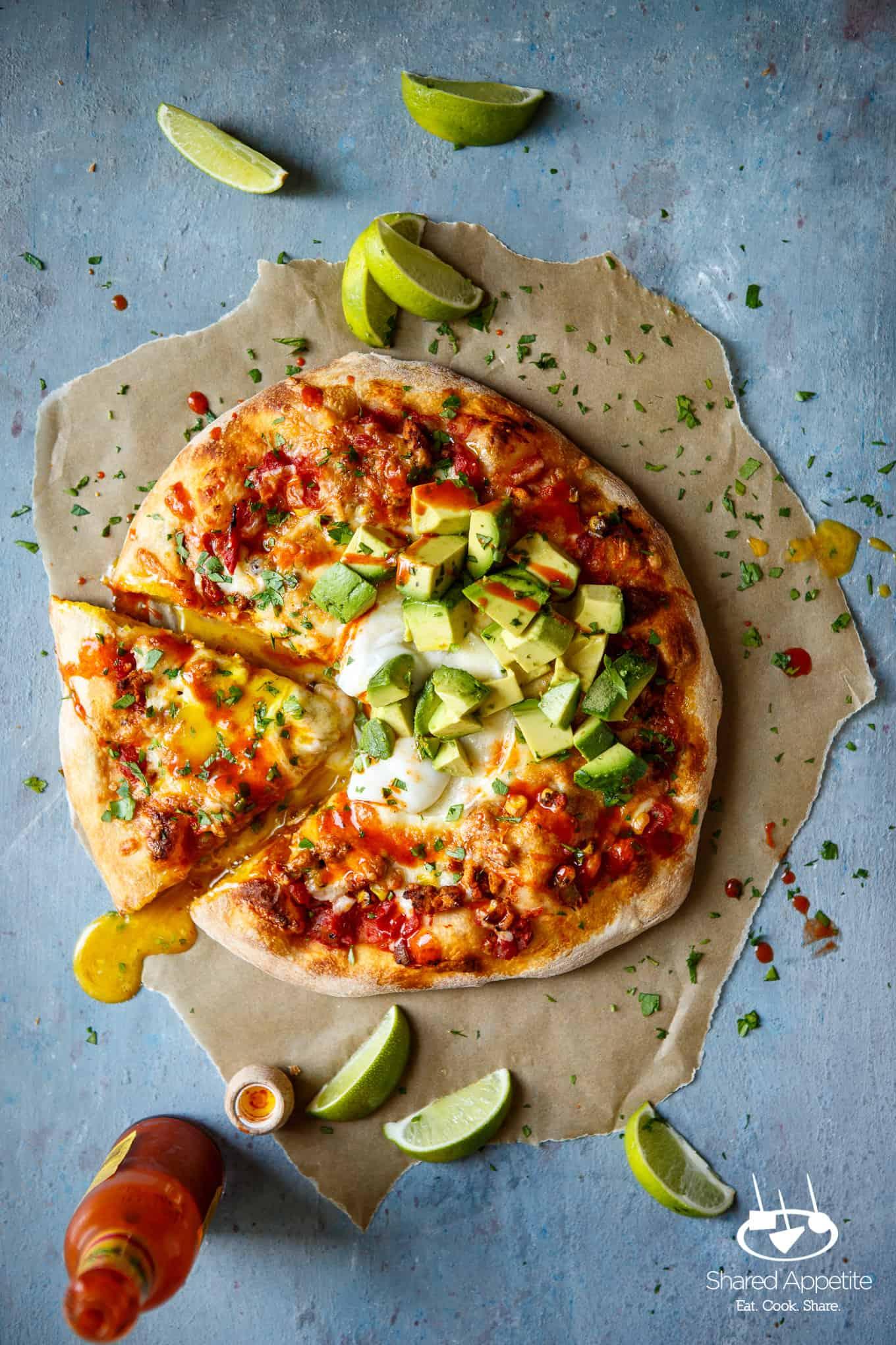 Dripping Egg Yolk from the Huevos Rancheros Pizza with Turkey Chorizo | sharedappetite.com