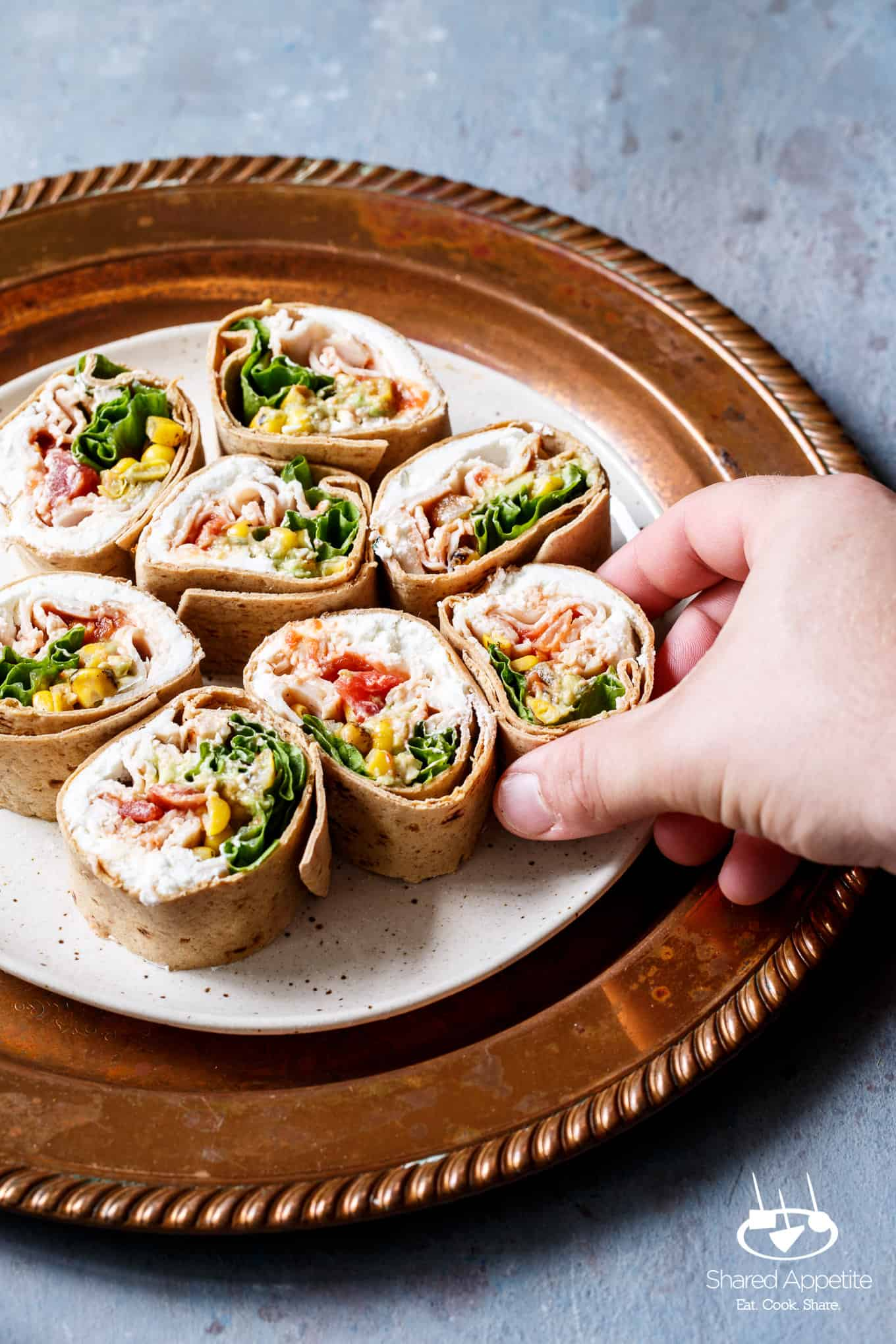 Grabbing a pinwheel of the Southwest Turkey Wraps | sharedappetite.com