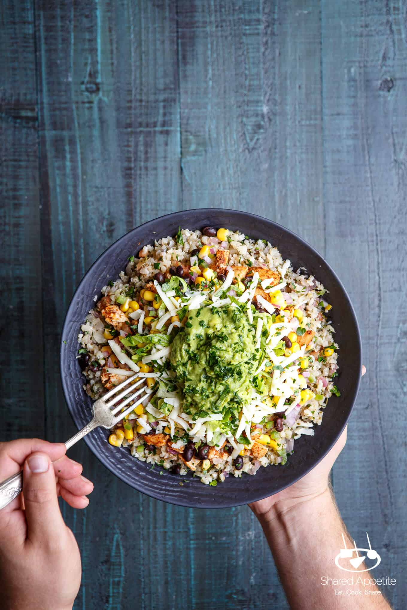 Eating with a fork the Healthy Cauliflower Rice Burrito Bowls | sharedappetite.com