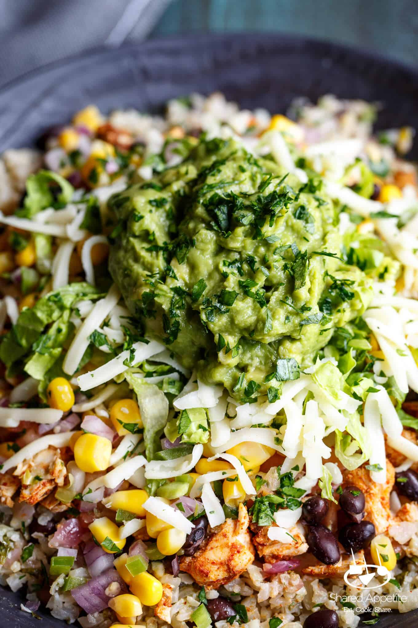 Zoomed in on the Guacamole on this Healthy Cauliflower Rice Burrito Bowls   sharedappetite.com