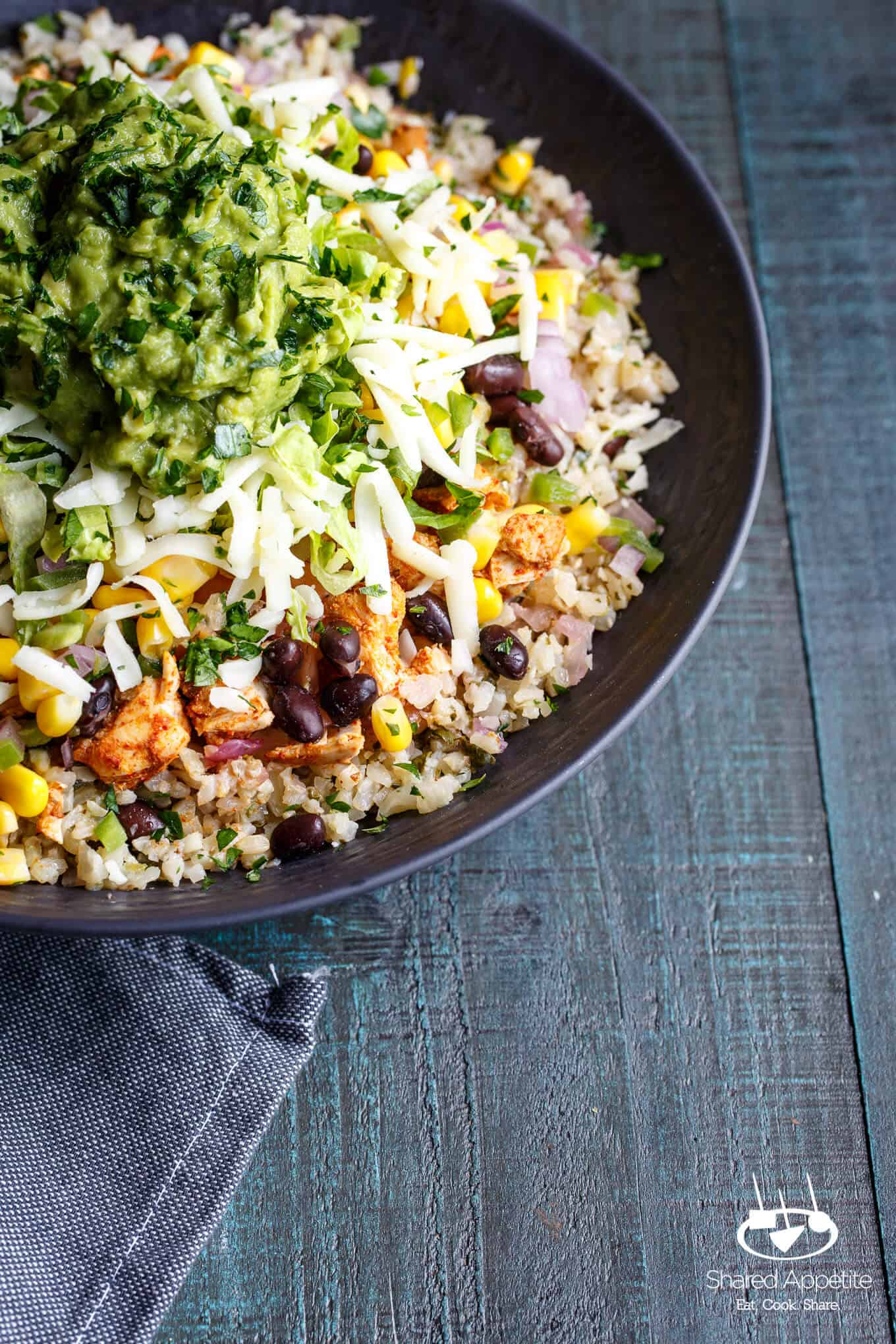 up close shot of the Healthy Cauliflower Rice Burrito Bowls | sharedappetite.com