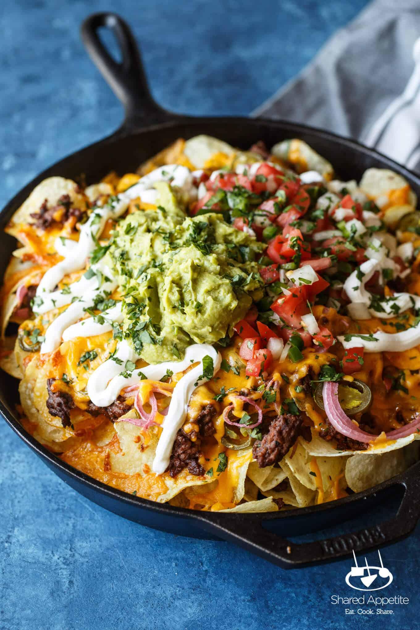 A closeup of the Skillet Loaded Taco Potato Chip Nachos | sharedappetite.com