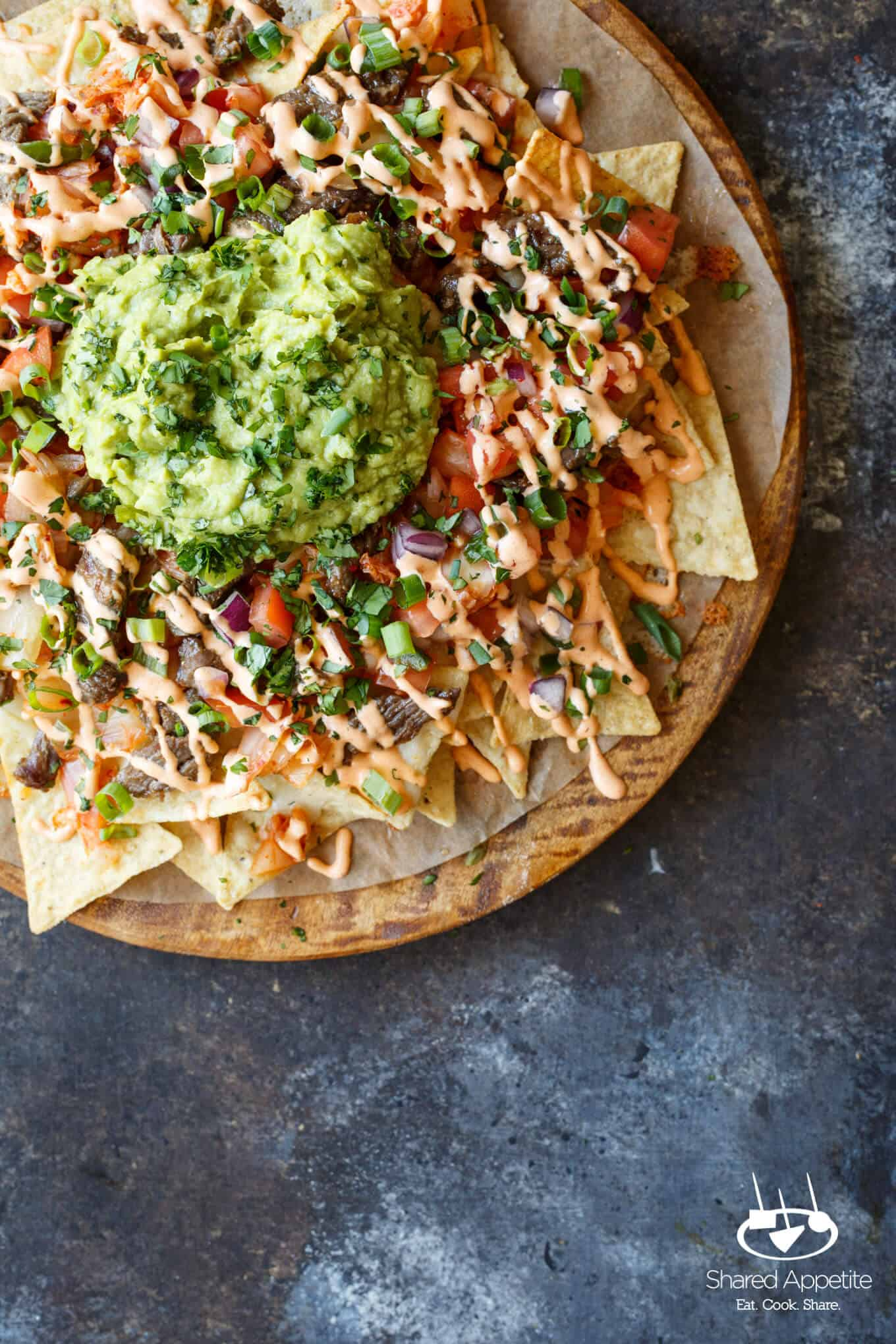 Bulgogi Korean Steak Nachos with Kimchi and Gochujang Aioli | sharedappetite.com