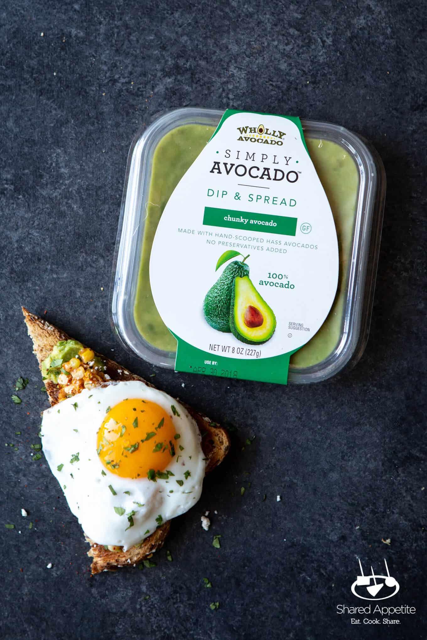 closeup of Elotes Avocado Toast with a Fried Egg   sharedappetite.com