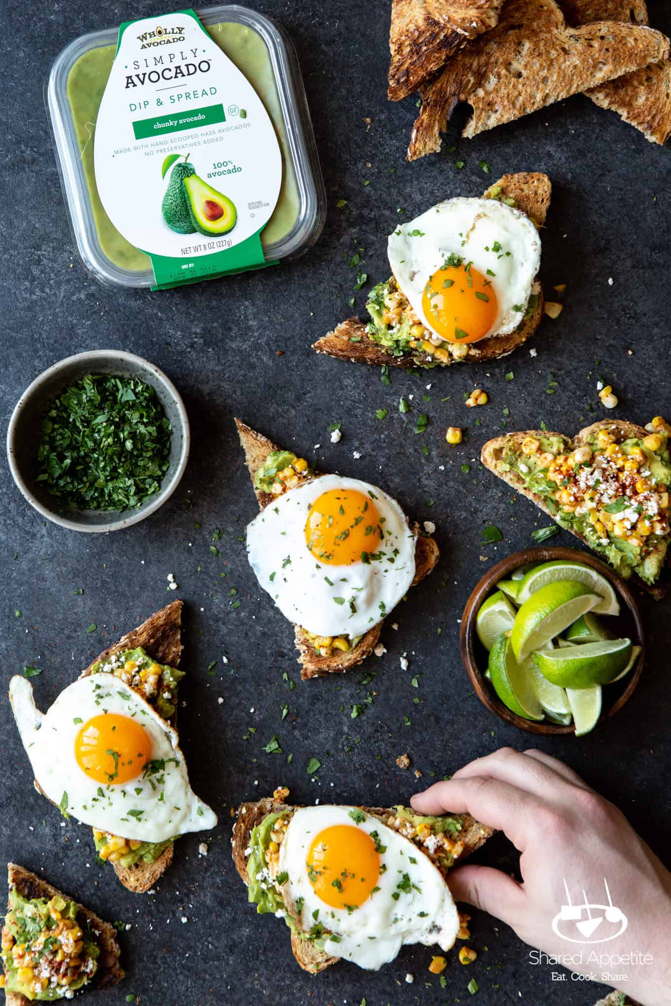 Grabbing an Elotes Avocado Toast with a Fried Egg   sharedappetite.com