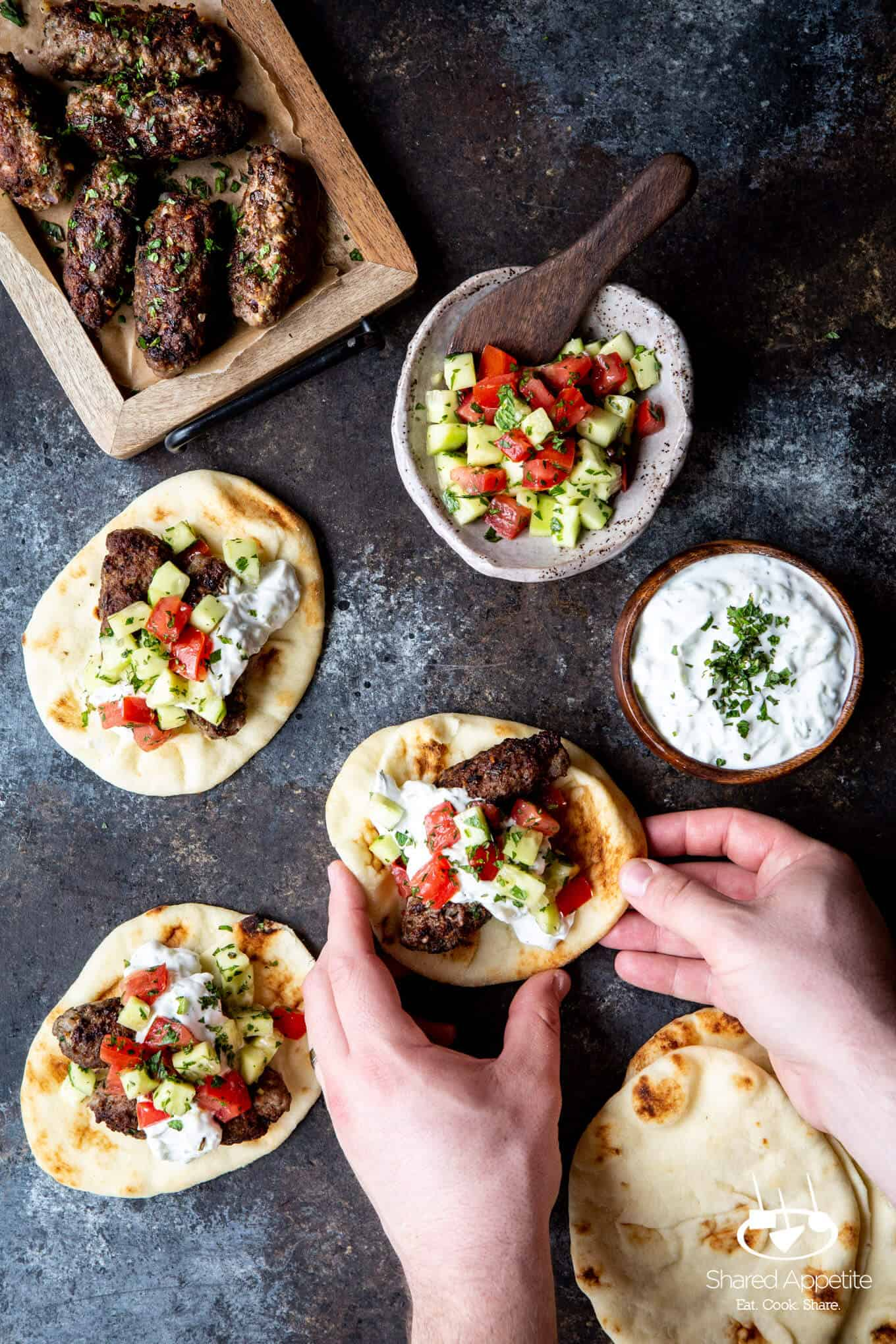 grabbing one of these Greek Lamb Tacos | sharedappetite.com