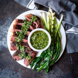 Sous Vide Steak with Chimichurri Sauce and Grilled Scallions