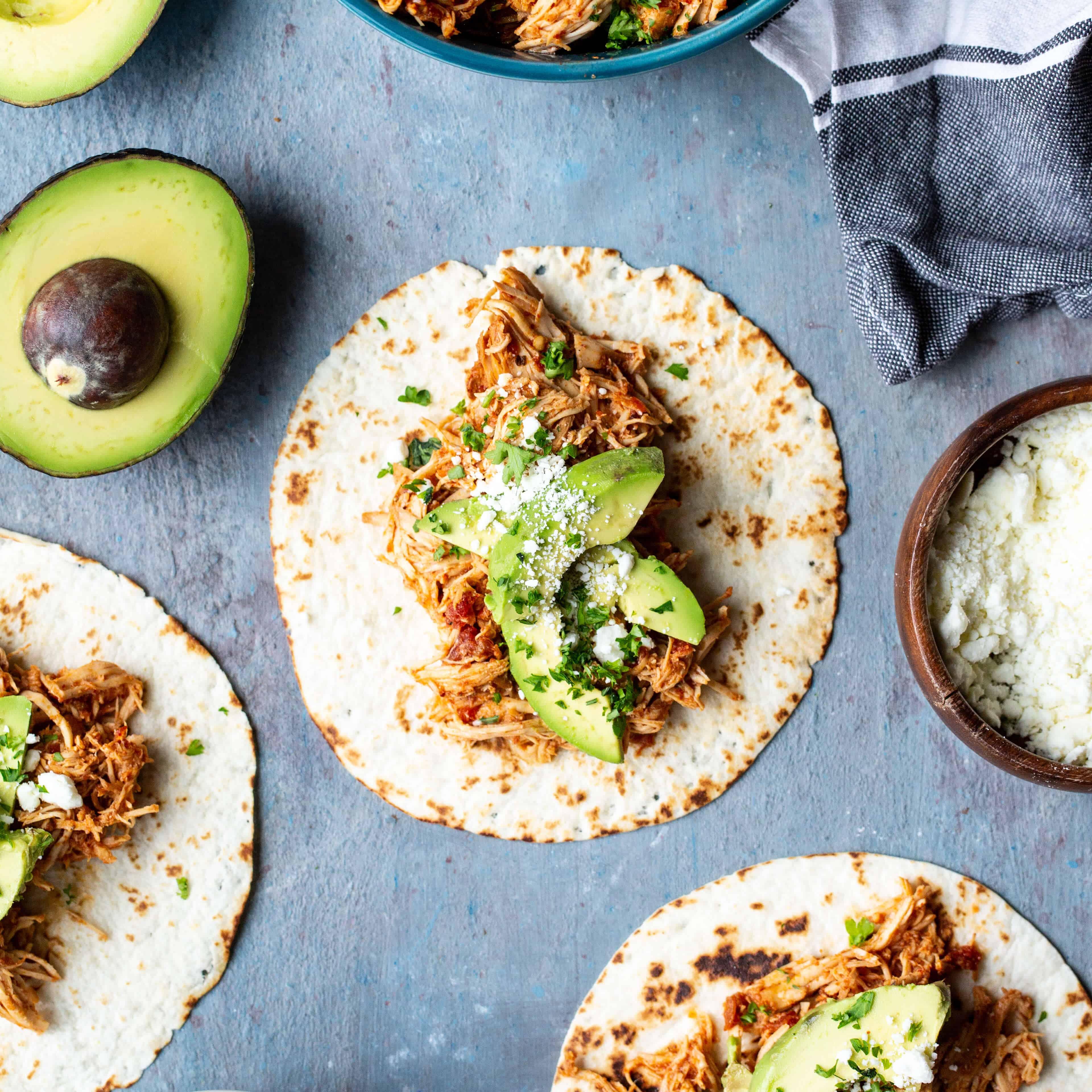 Slow Cooker Salsa Chicken Tacos   sharedappetite.com