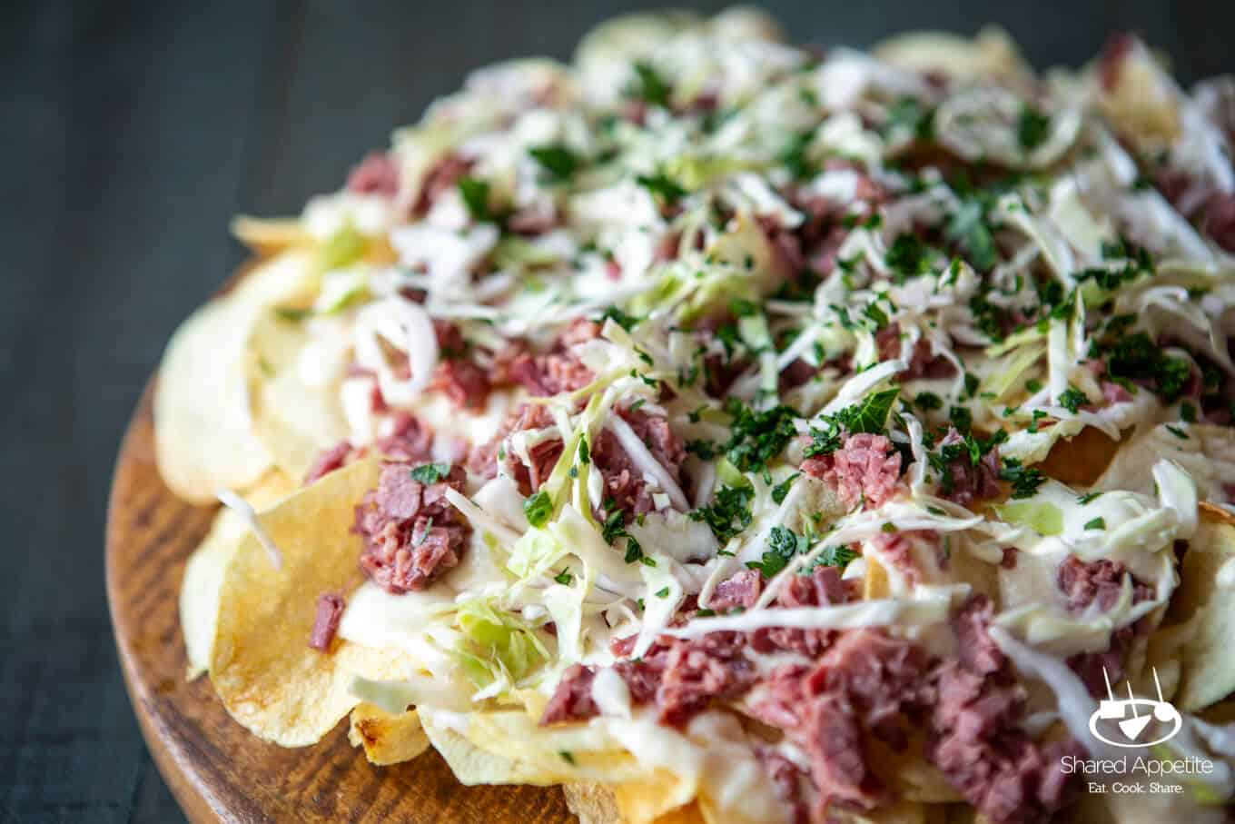 Irish Corned Beef Nachos with Swiss Cheese Queso and Pickled Cabbage for St. Patrick's Day | sharedappetite.com